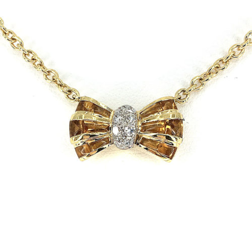 Necklace with 18 cabocon cut citrines (in the bow faceted below and cut to size) cts. 10.14 and with 10 natural brilliant cut diamonds. Color G. vs 0.24 cts. Length 40 cm