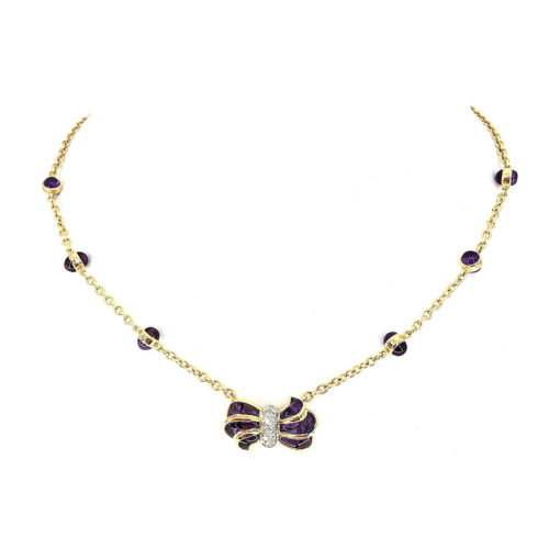 18kt yellow and white gold necklace g. 12.30 with 18 cabocon cut amethysts (faceted below and cut to size) cts. 11.98 and with 10 natural brilliant cut diamonds Color G vs 0.16 cts. Length 40 cm